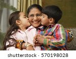 grandkids kiss grandmother... | Shutterstock . vector #570198028