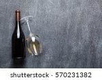 wine bottle and glass with... | Shutterstock . vector #570231382