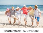 senior friends dancing on the... | Shutterstock . vector #570240202