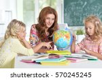 teacher with two girls    Shutterstock . vector #570245245