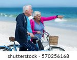 mature couple riding bicycles... | Shutterstock . vector #570256168