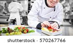 smiling chef putting a...   Shutterstock . vector #570267766