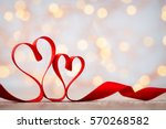 Stock photo two red hearts of ribbon valentines day greeting card 570268582