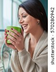 beautiful woman with cup of... | Shutterstock . vector #570280942