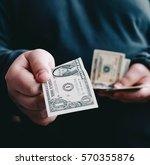 Man Giving One Us Dollar...