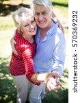 happy senior couple dancing... | Shutterstock . vector #570369232