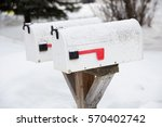 snow covered mailboxes in a...   Shutterstock . vector #570402742