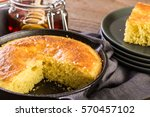 Stock photo slice of sweet cornbread with honey on the plate 570457102