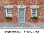 front door and two windows with ... | Shutterstock . vector #570473755
