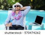 smart man holding martini glass ... | Shutterstock . vector #570474262