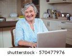 portrait of happy senior woman... | Shutterstock . vector #570477976