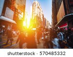 crowded people crossing road in ... | Shutterstock . vector #570485332