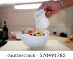 a man  is dip some milk on... | Shutterstock . vector #570491782