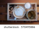 a cup of coffee with flower... | Shutterstock . vector #570495886