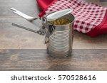 old opener open to metallic can ...   Shutterstock . vector #570528616