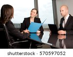 Small photo of Job interview with two persons from a human resources team and a candidate