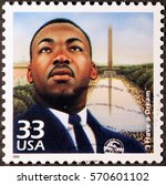 Small photo of Milan, Italy - January 30, 2017: Martin Luther King on american postage stamp