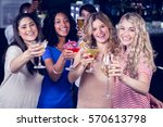friends drinking cocktails... | Shutterstock . vector #570613798