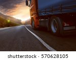 truck drives into sunset | Shutterstock . vector #570628105