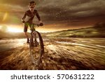 mountainbiker goes offroad | Shutterstock . vector #570631222