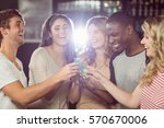 friends toasting with shots in... | Shutterstock . vector #570670006