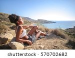 Girl Relaxing On A Cliff ...