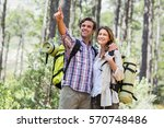 happy man pointing while... | Shutterstock . vector #570748486