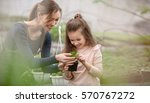 mother and daughter taking care of plants - stock photo