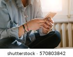 a young girl using a smartphone ... | Shutterstock . vector #570803842