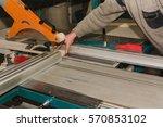 men at work sawing wood.... | Shutterstock . vector #570853102