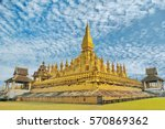 cloudy sky and pha that luang... | Shutterstock . vector #570869362