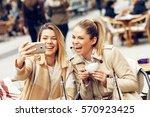 two women friends taking a... | Shutterstock . vector #570923425