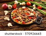 omelette with mushrooms and... | Shutterstock . vector #570926665