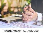 businessman hands clasped  | Shutterstock . vector #570939952