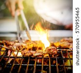 chef grilling lamb ribs on hot... | Shutterstock . vector #570955465