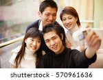 young adults posing for... | Shutterstock . vector #570961636