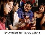 friends having drinks at bar | Shutterstock . vector #570962545