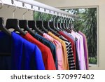 clothing on hanger at the... | Shutterstock . vector #570997402