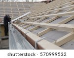 new roof construction on a... | Shutterstock . vector #570999532