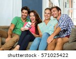 group of friends sitting on... | Shutterstock . vector #571025422