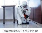 man doing pest control at home | Shutterstock . vector #571044412