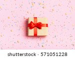 a gift on a pink background... | Shutterstock . vector #571051228