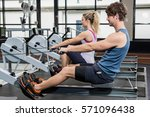 man and woman working out on... | Shutterstock . vector #571096438