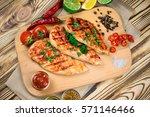 top view of grilled chicken... | Shutterstock . vector #571146466
