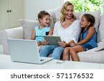 happy mother sitting with... | Shutterstock . vector #571176532