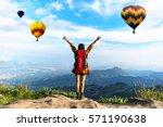 hiker woman feeling victorious... | Shutterstock . vector #571190638
