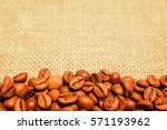 coffee beans on burlap... | Shutterstock . vector #571193962