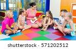 smiling glad children sitting... | Shutterstock . vector #571202512