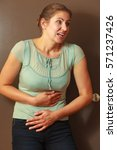 Small photo of Aches and pains concept. Woman having bad ache and pain. Female placing hands on stomach.