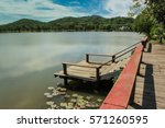 wooden terrace and lake | Shutterstock . vector #571260595